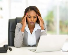 30664548 - stressed african businesswoman sitting in office