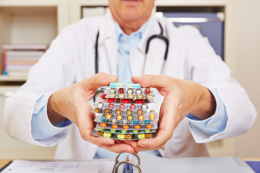 doctor holding many different colorful pills in in hands